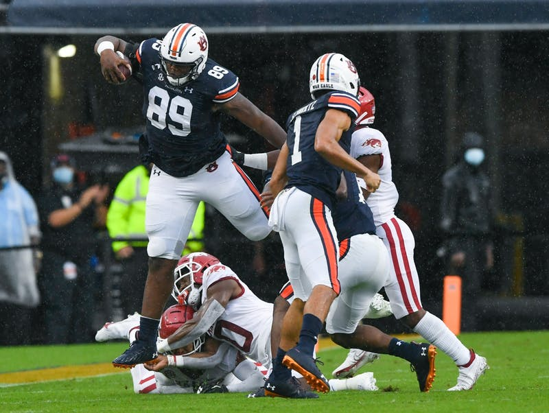 Auburn tight end J.J. Pegues hurdles an Arkansas defender.