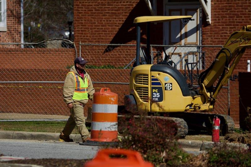 A worker walks past the scene of the leak, on Thursday, Feb. 27, 2020, in Auburn, Ala.