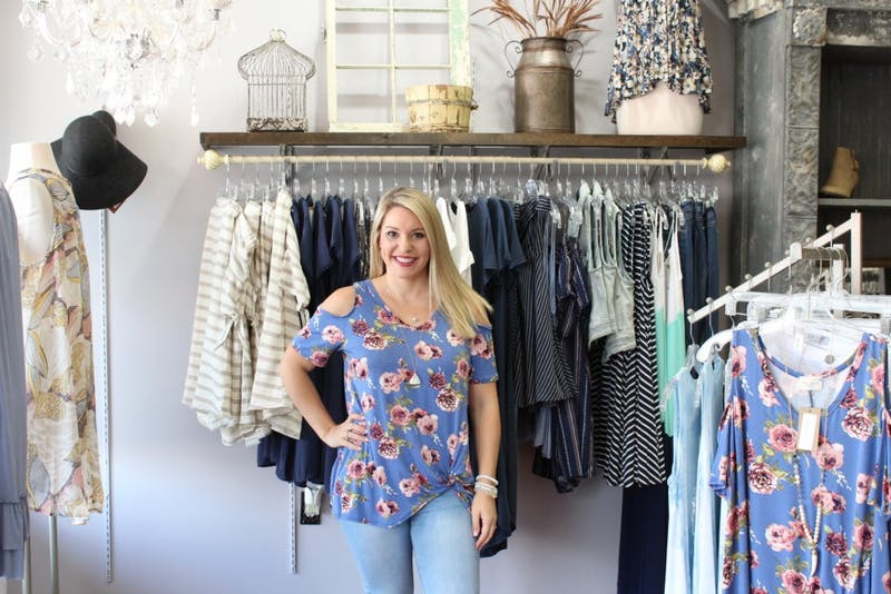 Beth Register owner of EB Downtown in an outfit from her boutique on Thursday, July 13, 2017 in Auburn, Ala.