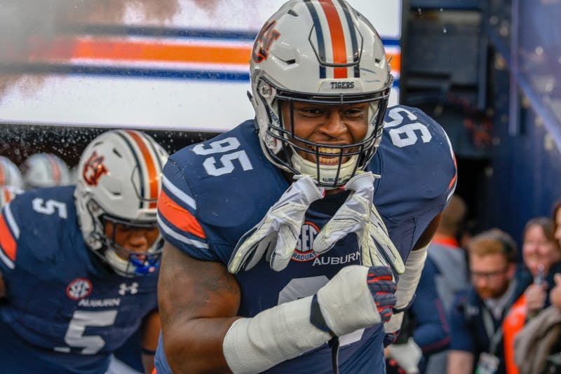Dontavius Russell (95) runs onto the field prior to Auburn Football vs Liberty on Saturday,  Nov. 17, 2018, in Auburn, Ala.