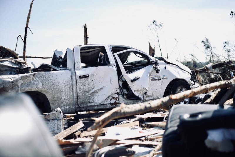 A white truck sits on top of remains of homes on Thursday, March 7, 2019 in Beauregard, Ala.