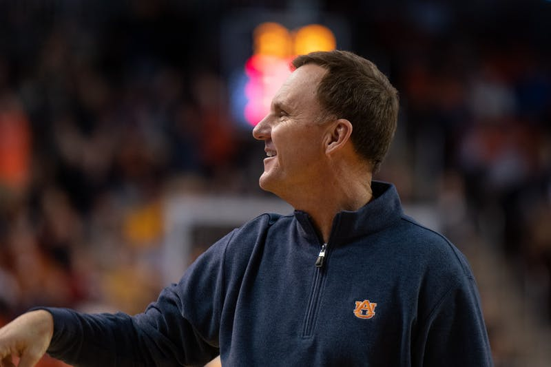 Auburn football offensive coordinator Chad Morris waves to the crowd during Auburn Men's Basketball vs. Iowa State on Sat, Jan. 25, 2020, in Auburn, Ala.