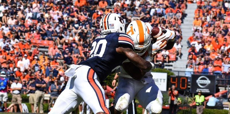 Jeremiah Dinson (20) makes a tackle during Auburn football vs. Tennessee on Oct. 13, 2018, in Auburn, Ala.