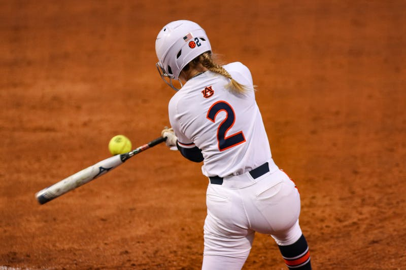 Sydney Cox (2) hits the ball during the game between Auburn and Kentucky at Jane B. Moore Field on April 16, 2021; Auburn, AL, USA. Photo via: Jacob Taylor/AU Athletics