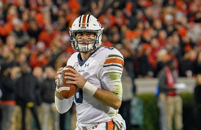 Jarrett Stidham (8) looks to pass during Auburn football vs. Georgia on Nov. 10, 2018, in Athens, Ga.