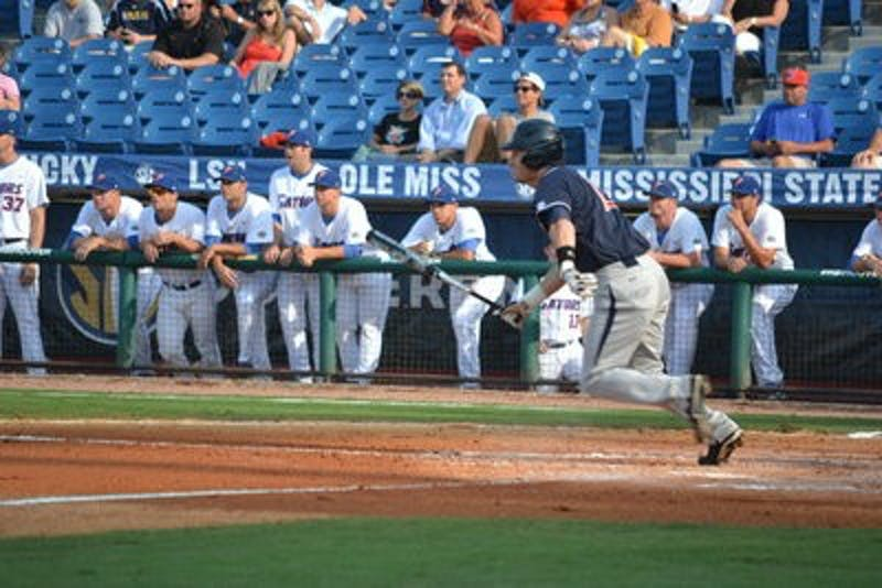 Zachal Alvord gets a hit during the SEC Championship game Tuesday afternoon in Hoover, AL. (Danielle Lowe / PHOTO EDITOR)