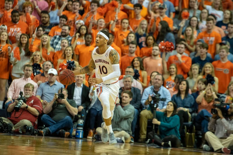 Samir Doughty (10) runs up the court during Auburn Men's Basketball vs. Alabama, on Wed, Feb. 12, 2020, in Auburn, Ala.