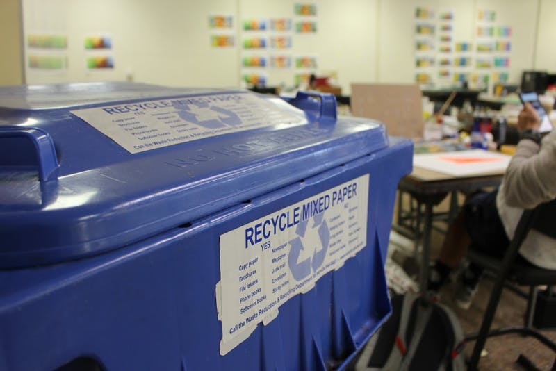 Recycling bins line the studios of Wallace Hall and are one way to help live sustainably.