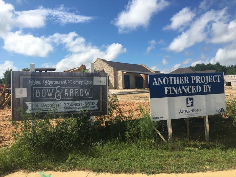 A sign advertising the Bow & Arrow restaurant stands outside its construction on Saturday, Sep. 9, 2018, in Auburn, Ala.