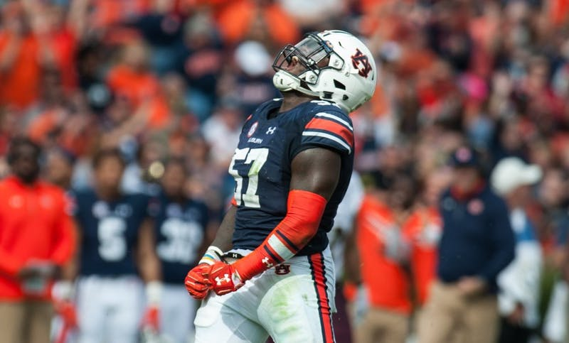 Deshaun Davis (57) celebrates after a sack in the first half. Auburn vs ULM on Saturday, Nov. 18 in Auburn, Ala.