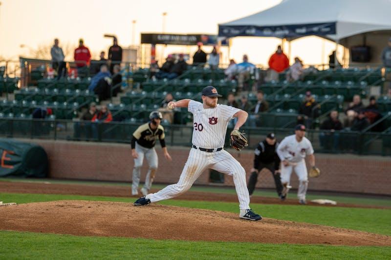 Cody Greenhill (20) throws the pitch during Auburn Baseball vs UCF on Friday, Feb. 21, 2020, in Auburn, Ala.