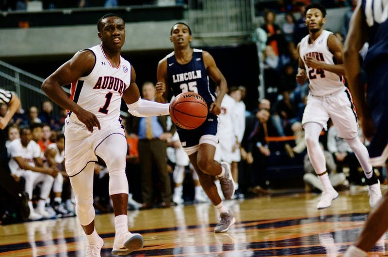 Jared Harper (1) drives the ball down the court during the last second of the first half during Auburn Men's Basketball vs. Lincoln Memorial on Nov. 2, 2018, in Auburn, Ala.