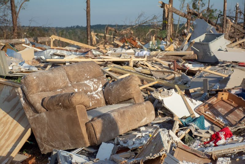 A couch sits on a pile of wreckage on March 4, 2019, in Beauregard, Alabama, after a tornado killed 23 people and left dozens of other injured and without homes.