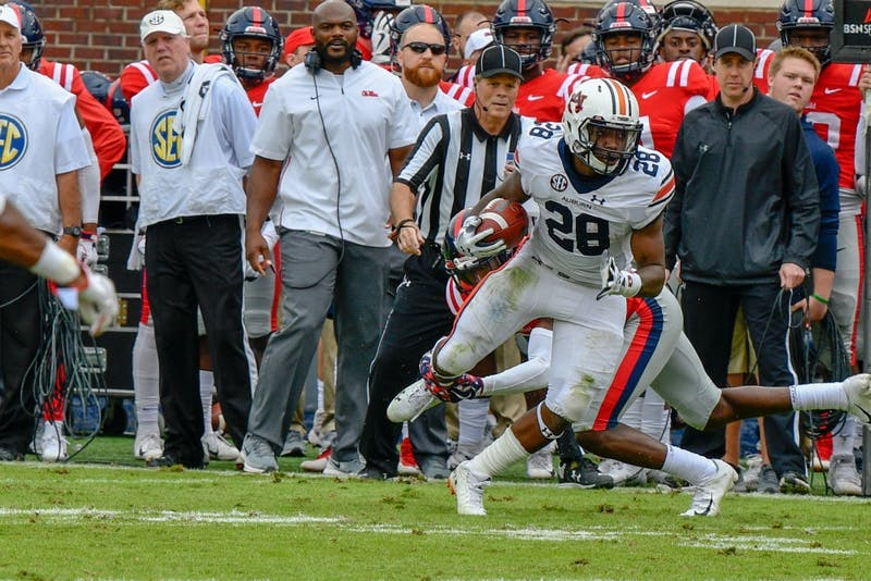 JaTarvious Whitlow (28) runs the ball during Auburn Football vs. Ole Miss on Saturday, Oct. 20, 2018, in Oxford, Miss.