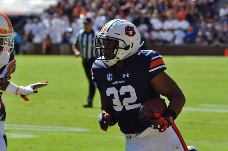 Malik Miller (32) runs the ball during Auburn Football vs. Tennessee on Saturday, Oct. 13, 2018 in Auburn, Ala.