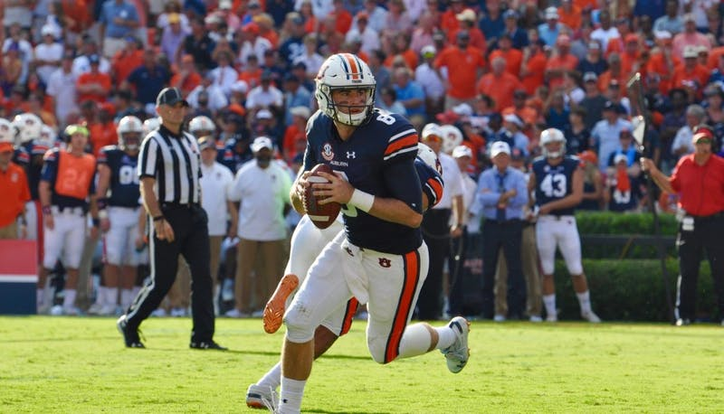 Jarrett Stidham (8) rolls out to pass during Auburn football vs. LSU on Sept. 15, 2018, in Auburn, Ala.