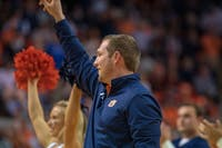 Kenny Dillingham Auburn Footballs's new Offensive Coordinator, waves to the crowd during Auburn Basketball vs. Kentucky, on Saturday, Jan. 19, 2019 in Auburn, Ala.