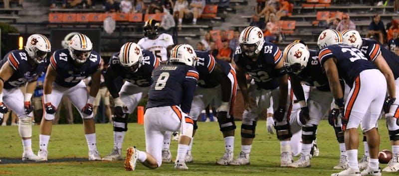 Jarrett Stidham (8) huddles with his offensive line during Auburn football vs. Southern Miss on Sept. 29, 2018, in Auburn, Ala.