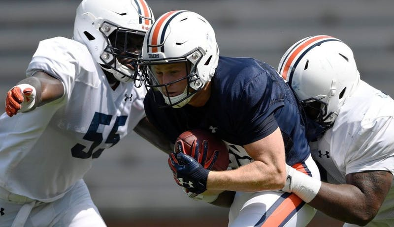 Griffin King is tackled by Coynis Miller Jr and T.D. Moultry. Auburn football scrimmage 2 on Wednesday, Aug. 15, 2018 in Auburn, Ala.