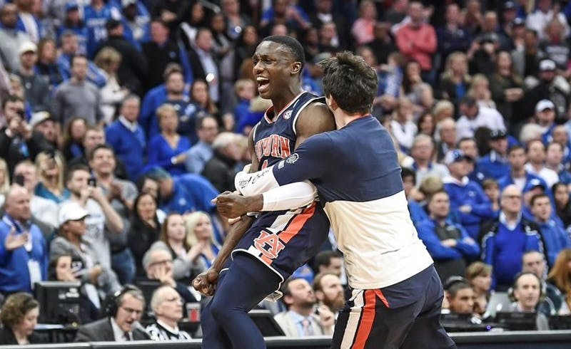 Jared Harper (1) celebrates Auburn's Elite Eight victory over Kentucky on March 31, 2019, in Kansas City, Mo.