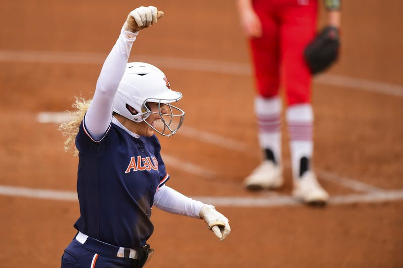 Auburn Tigers Alyssa Rivera (21) reacts while running to home plate during the first game between Auburn and Southeast Missouri State at Jane B. Moore Field on Feb 13, 2021; Auburn, AL, USA. Photo via: Shanna Lockwood/AU Athletics