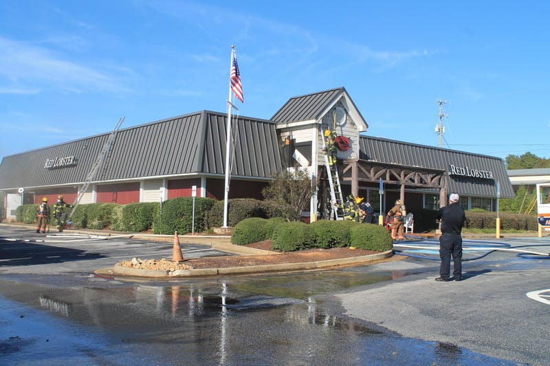Firefighters investigate the source of the fire at the Red Lobster on Nov. 3, 2019, on Opelika Road in Auburn, Ala.