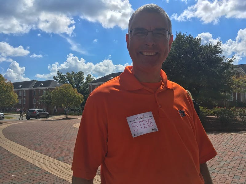 Auburn University employees carry on the Hey Day tradition on Oct. 3, 2018 in Auburn, Ala.