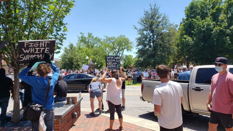 Hundreds of protestors held signs and chanted in downtown Auburn following the death of George Floyd