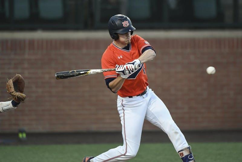 Matt Scheffler (6) swings for the ball during Auburn baseball vs. Georgia Tech on April 2, 2019, in Auburn, Ala.