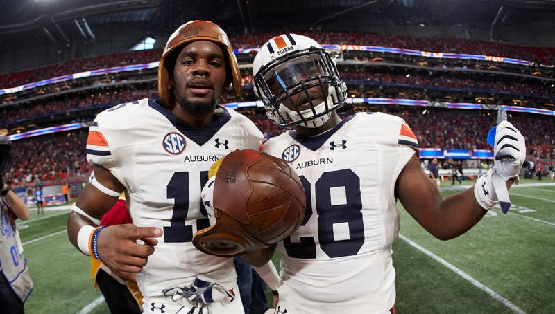 The Auburn Tigers celebrate with the Old Leather Helmet after winning the Chick-fil-A Kickoff at Mercedes-Benz Stadium, Saturday, September 1, 2018, in Atlanta. (Paul Abell via Abell Images for Chick-fil-A Kickoff)