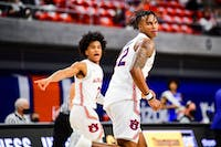 Jan 9, 2021; Auburn, AL, USA; Auburn Tigers guard Sharife Cooper (2) and guard Allen Flanigan (22) react after a play during during the game between Auburn and Kentucky at Auburn Arena. Mandatory Credit: Shanna Lockwood/AU Athletics