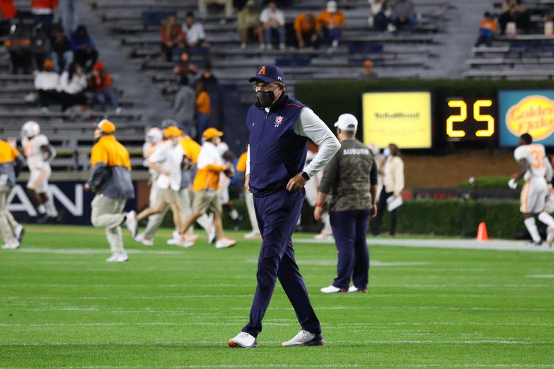 Gus Malzahn on the field coaching during warmups before Auburn vs. Tennessee on Nov. 21, 2020, in Auburn, Ala.
