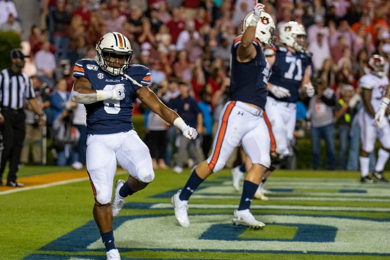 Shaun Shivers (8) celebrates after scoring a touchdown during Auburn Football vs. Alabama, on Saturday, Nov. 30, 2019, in Auburn, Ala.