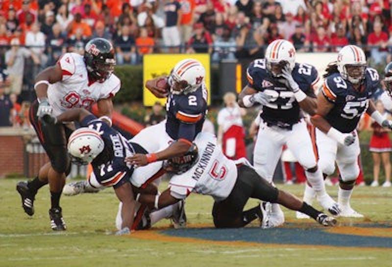 Junior quarterback Cam Newton makes a run against Arkansas State. (Emily Adams/PHOTO EDITOR)