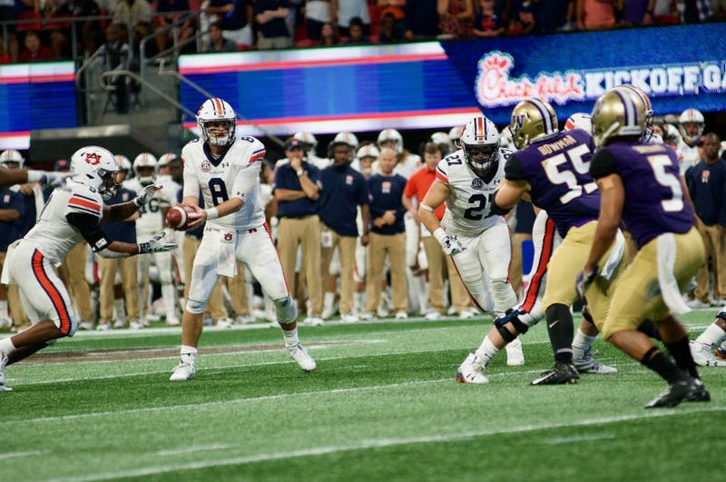 Jarrett Stidham (8) looks to make a pass during Auburn Football vs. Washington on Saturday, Sept. 1, 2018 in Atlanta, Ga.