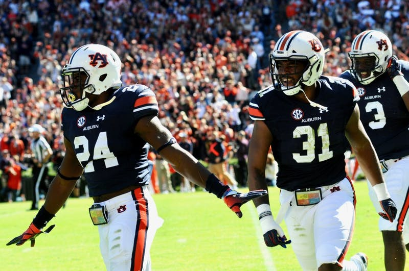 Daniel Thomas (24), Chandler Wooten (31) and Marlon Davidson (3) celebrate during the first half of Auburn Football vs. Texas A&M on Saturday, Nov. 3, 2018, in Auburn, Ala.