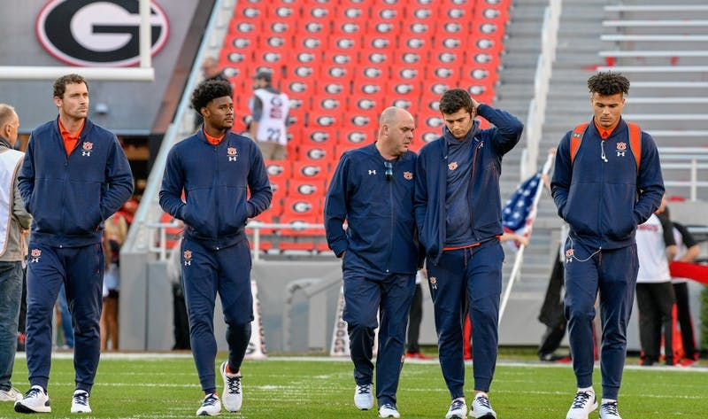 From left to right: Cord Sandberg, Malik Willis, offensive coordinator Chip Lindsey, Jarrett Stidham and Joey Gatewood walk the field prior to Auburn Football vs. Georgia on Saturday, Nov. 10, 2018, in Athens, Ga.