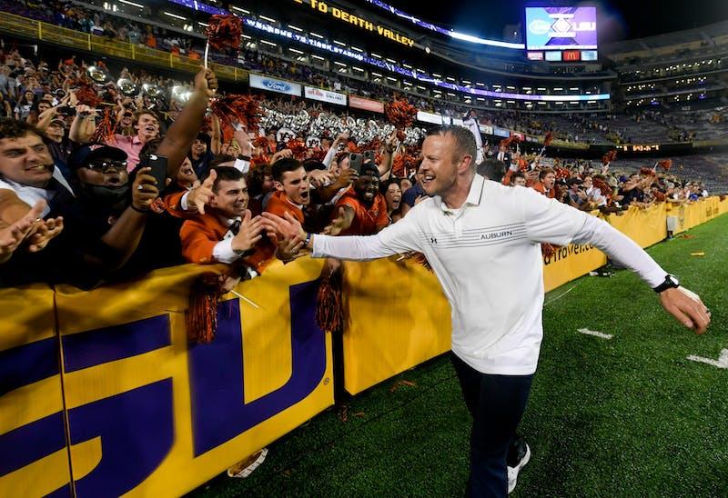 Oct 3, 2021; Baton Rouge, LA, USA; Head Coach Bryan Harsin and fans between Auburn and Louisiana State University at Tiger Stadium. Mandatory Credit: Todd Van Emst/AU Athletics