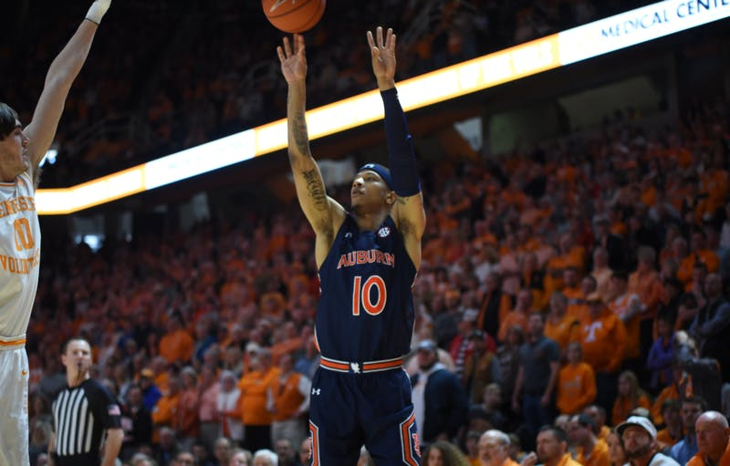 Samir Doughty (10) hit a career-high eight 3s against Tennessee. (Auburn Athletics, @AuburnMBB on Twitter).
