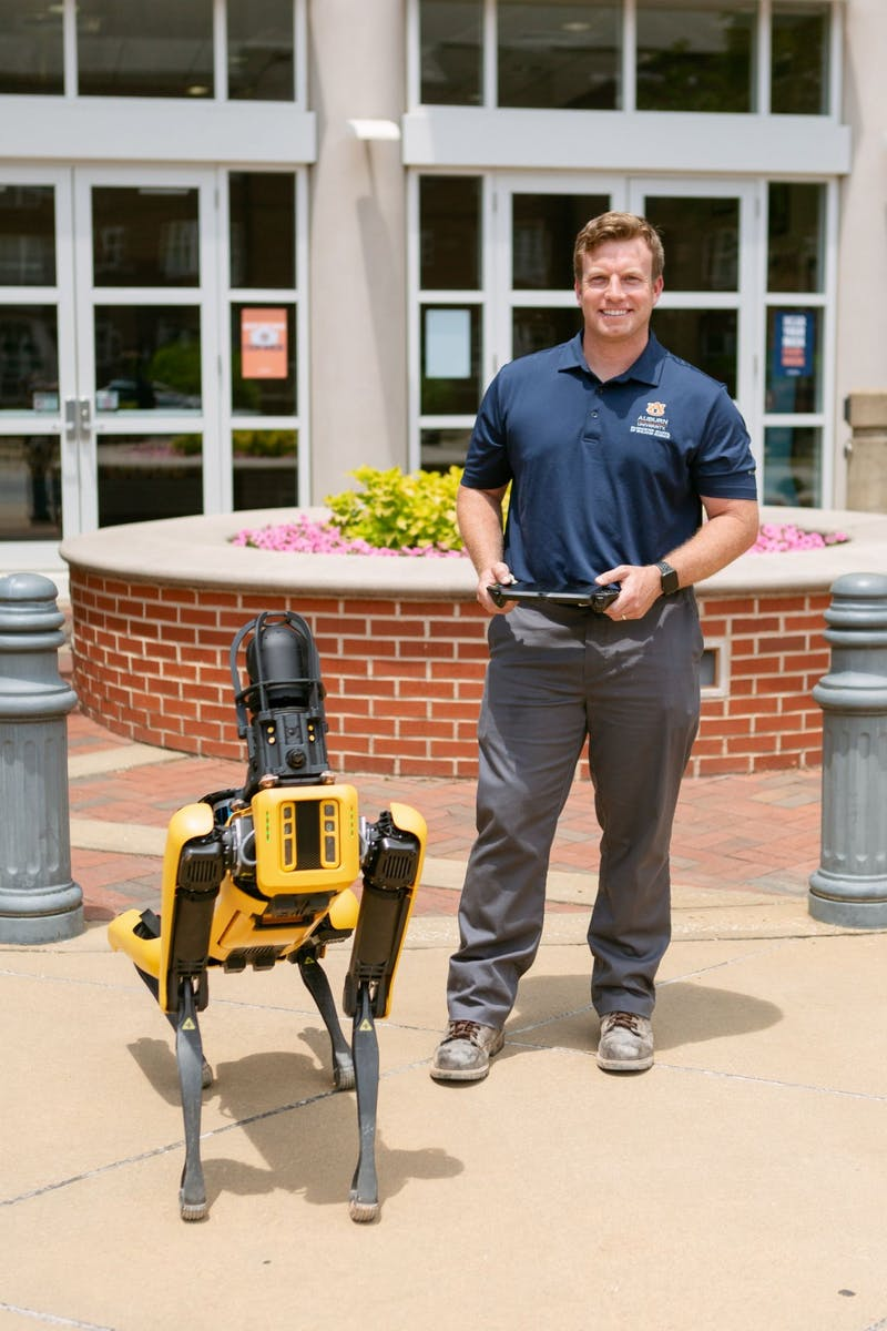 Eric Wetzel, assistant professor of the McWhorter School of Building Science, uses the robotic dog, Mac, to conduct research and as an outreach and learning tool.
