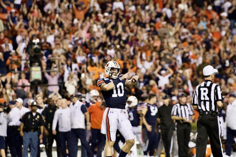 Bo Nix (10) hypes up the crowd during the Auburn vs. Alabama game on Saturday, Nov. 30, 2019, in Auburn, Ala.