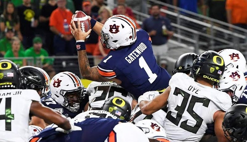 Joey Gatewood (1) leaps for a touchdown during Auburn vs. Oregon on Aug. 31, 2019, in Arlington, Texas.