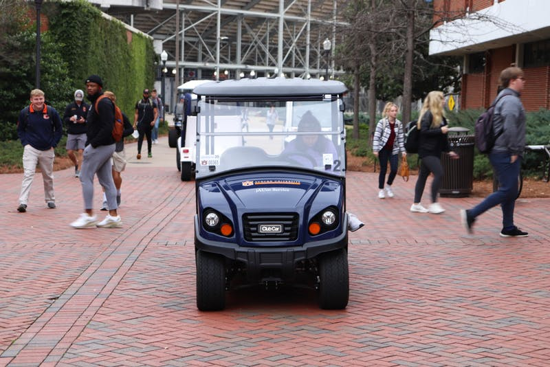 Auburn University jAUnt golf cart waits to pick up student at the Haley Center on Feb. 26, 2020, in Auburn, Ala.