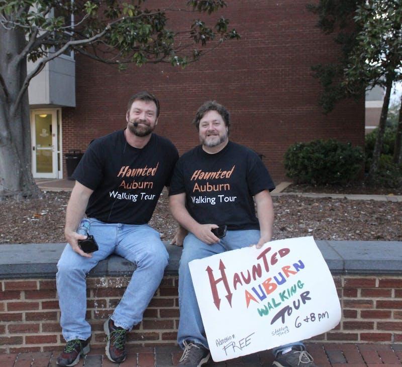 Brandon Stoker and John-Mark Poe, tour guides for the Haunted Auburn Walking Tour, on Oct. 22, 2017, in Auburn, Ala.