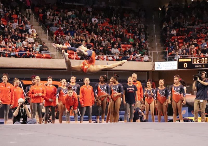 Abby Milliet performing on the floor during Auburn gymnastics vs. Arkansas on Feb. 15, 2019, in Auburn, Ala.