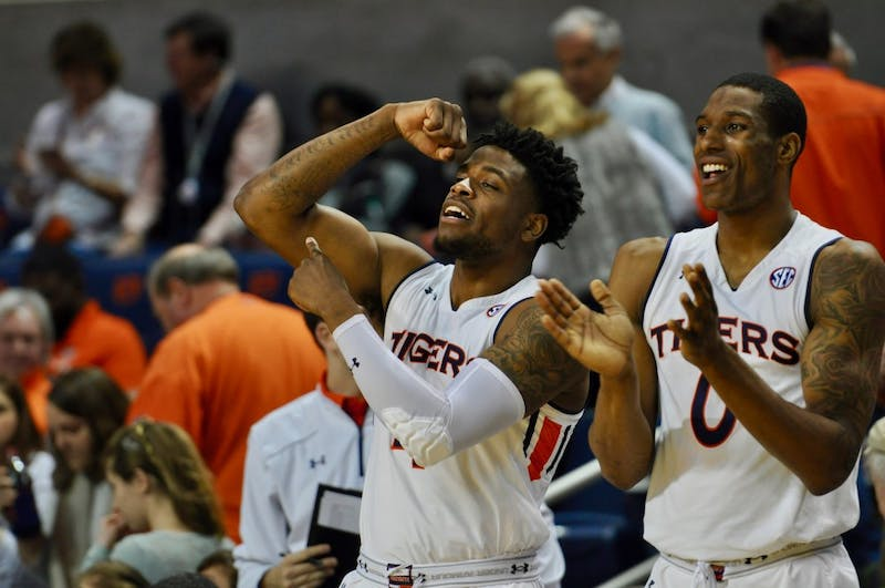 Horace Spencer (0) and Malik Dunbar (4) celebrate during Auburn Men's Basketball vs. Georgia on Sat, Jan. 12, 2019 in Auburn, Ala.