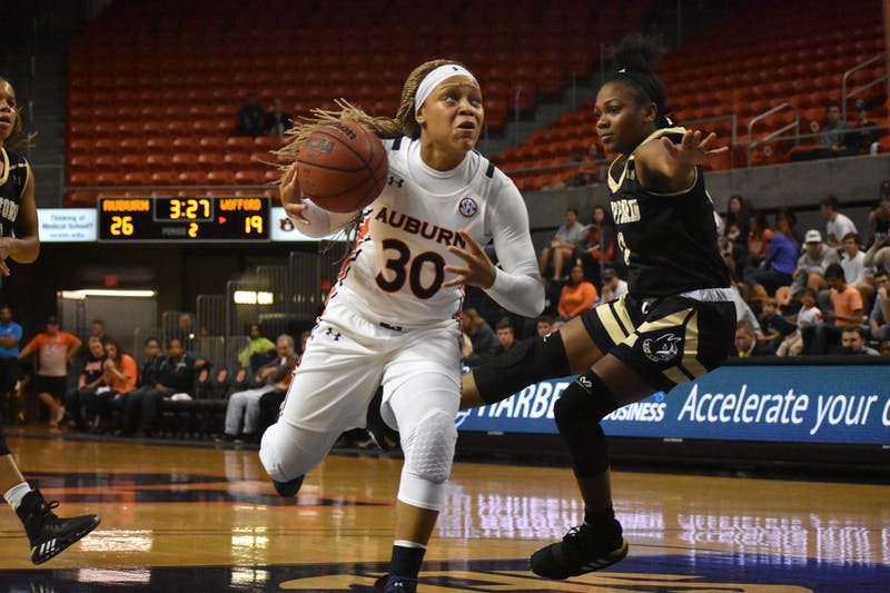 Auburn player Morgan Robinson-Nwagwu (30) moves down the court at the Auburn v. Wofford Women's Basketball Game on November 6, 2019 in Auburn, AL