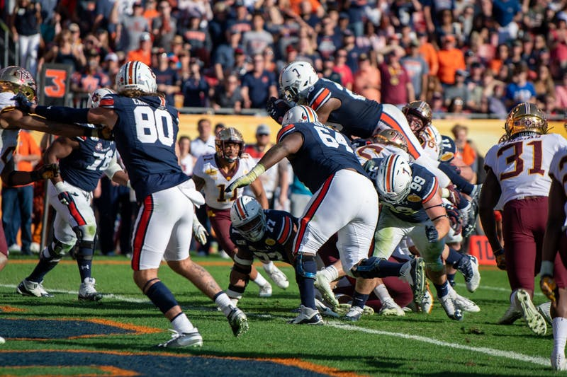 JaTarvious Whitlow (28) leaps for a touchdown during Auburn vs. Minnesota on Jan. 1, 2020, in Tampa, Fla.