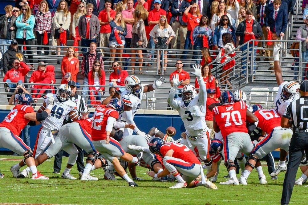 Auburn D-linemen Nick Coe, Marlon Davidson feast on Rebels in win