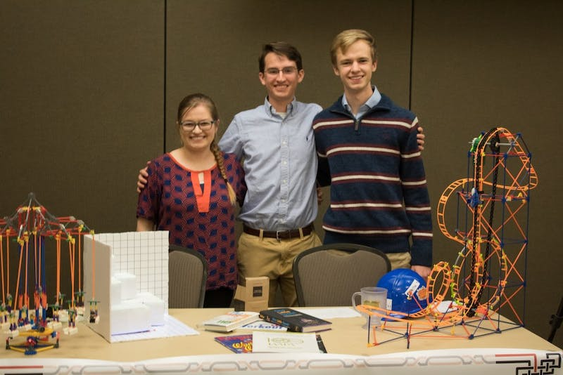 Katie Bowman, Seth Harris, and Gavin Prather represent the Theme Park Engineering Group at the Organization Showcase in the Student Center Ballroom on Tuesday, March 20, 2018 in Auburn, Ala.